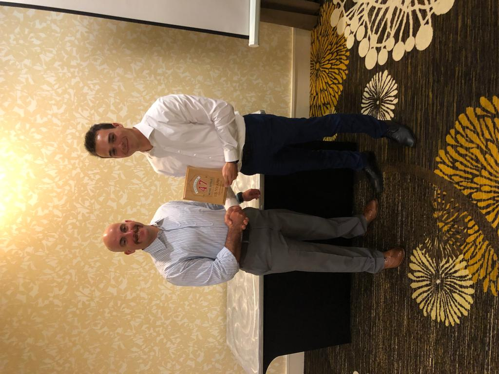 Membership Secretary Jack Jacobson (R) presents Fire Chief Michael Esterlis (L) a 15 Years Of Continuous Service Award.