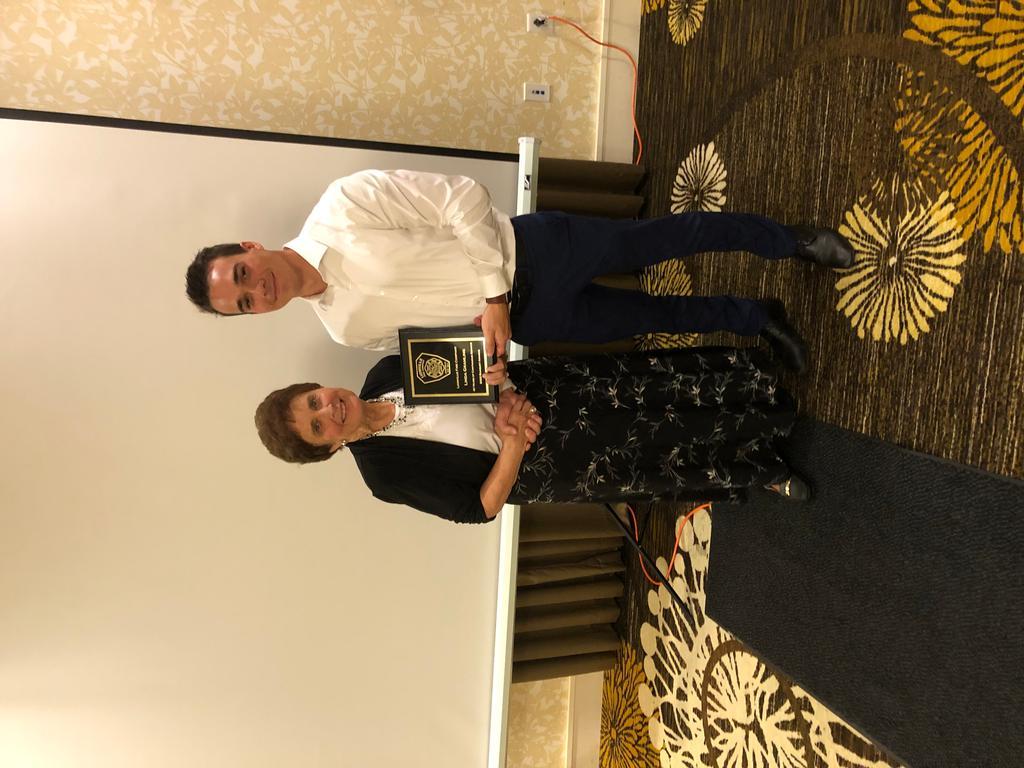 Membership Secretary Jack Jacobson (R) presents Linda Gramling (L) a 40 Years Of Continuous Service Award.
